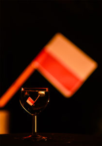 Polish flag in a glass reflection