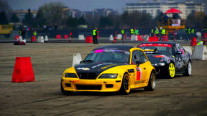 Yellow and black cars in a race