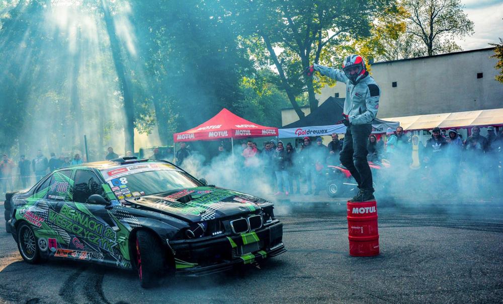 Drift show on a quad and BMW car